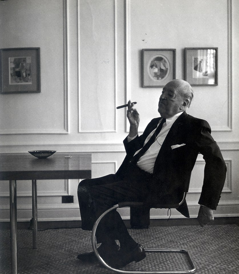 Mies Van Der Rohe Smoking A Cigar Sitting On One Of His